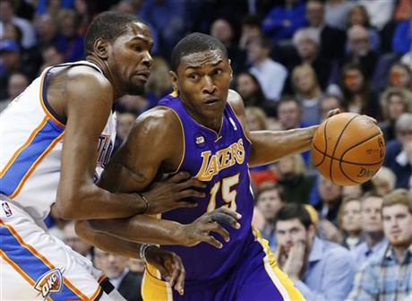 In this March 5, 2013, file photo, Los Angeles Lakers forward Metta World Peace (15) drives around Oklahoma City Thunder forward Kevin Durant during an NBA basketball game in Oklahoma City. The Los Angeles Lakers have re-signed forward Metta World Peace, Thursday, Sept. 24, 2015. (AP Photo/Sue Ogrocki, File)