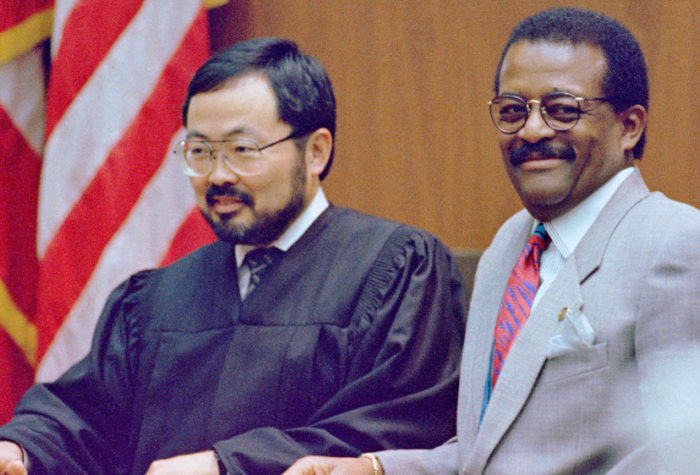 While waiting for a sidebar to take place with the rest of the lawyers it the bench.  Judge lance Ito and Johnny Cochran break out into laughter.  Being the only photojournalist that was there every day I develop the relationship with all the principals of the trial.  On this particular day defense Atty. Johnny Cochran saw the camera pointed toward the two of them and mentioned it to the judge.  The judge briefly looked in my direction started to let turned away as defense Atty. Cochran continued to look in my direction with both being amused.