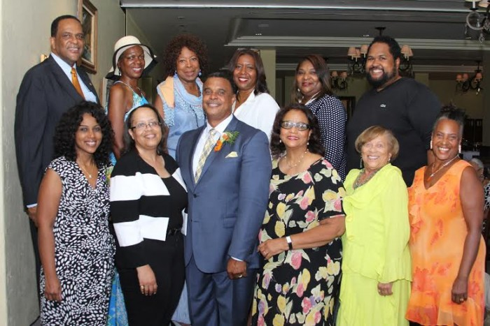 Pastor James K. McKnight (3rd from left) gathers with members of the anniversary committee. From left (1st row) are Kameron Burwell, chair; Stani Baker, Carol Hall Holliday, Marcia Gleason, Ellen Love, (2nd row) G. Bernard Brown, Donna Brooks, Virginia P. Bland, Sherri McGee McCovey, Susan Comrie and Ashley Faatoalia.