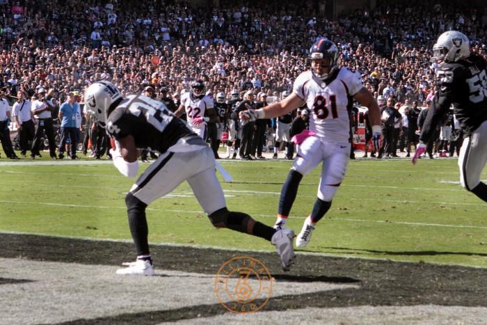 Charles Woodson Intercepts Pass During Raiders v. Broncos game.  Photo:  Jevone Moore