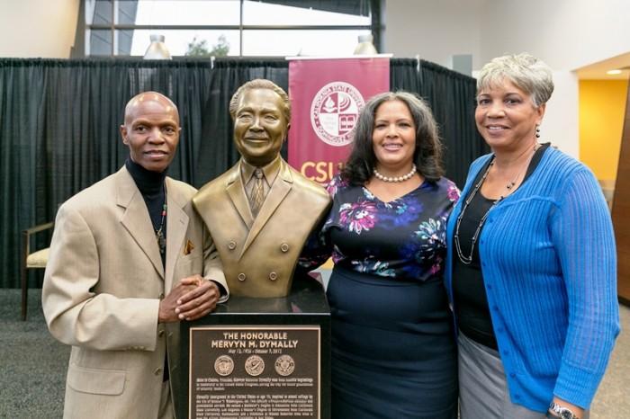 Mervyn M. Dymally bust sculptor Nijel Binns, Dymally's daughter Lynn, and Brenda Riddick, director of the Mervyn M. Dymally African American Political and Economic Institute. (Photo by Nate Brown/CSUDH)