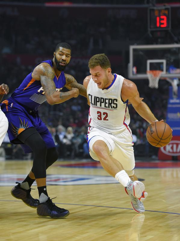 Clippers Forward Blake Griffin dribbles past Phoenix Suns forward Markieff Morris.   AP Photo:  Mark J. Terrill
