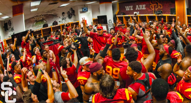 Coach Helton Celebrates with Trojans After Defeating UCLA, 20-14 Photo:  USC Chronicles