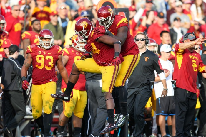 Trojans Defense Celebrates! Photo:  Jordon Kelly