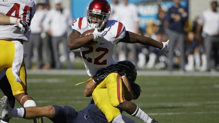 Justin Davis Carries the ball for USC Photo:  AP/Eric Risberg