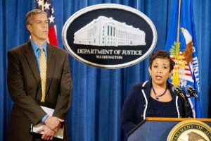 Attorney General Loretta Lynch, accompanied by Education Secretary Arne Duncan, speaks at a news conference at the Justice Department in Washington, Monday, Nov. 16, 2015, to announce a major federal and state civil litigation settlement concerning Educational Management Corp., a Pittsburgh-based company that runs for-profit trade schools. Lynch also commented about the recent attacks in Paris, France. (AP Photo/Andrew Harnik)