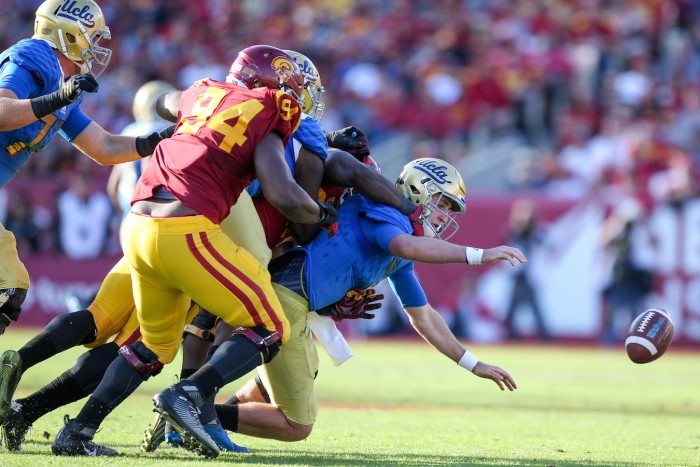 Defensive End Rasheem Green Recovers Fumble for Trojan TD. Photo:  Jordon Kelly