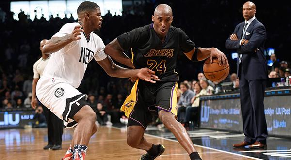 Los Angeles Lakers forward Kobe Bryant (24) drives the ball around Brooklyn Nets forward Joe Johnson. (Kathy Kmonicek//AP)