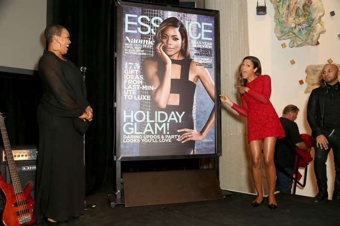 Naomie Harris and Essence West coast editor Regina Robertson unveil her magazine cover. (Getty Images)