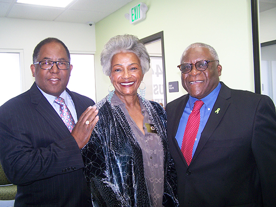County Supervisor Mark Ridley-Thomas (left) greets Mental Health Commissioners Jo Helen Graham and Herman DeBose, PhD, at the ribbon-cutting ceremony for the Westside Mental Health Urgent Care Center on Dec. 7.