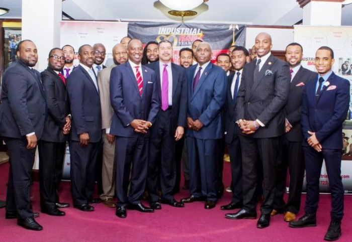 USBC CEO Ron Busby Sr. (center left, red tie), with Industrial Bank CEO Doyle Mitchell along with members of the Black Male Entrepreneurship Institute. Photo by Ashlei Sutton