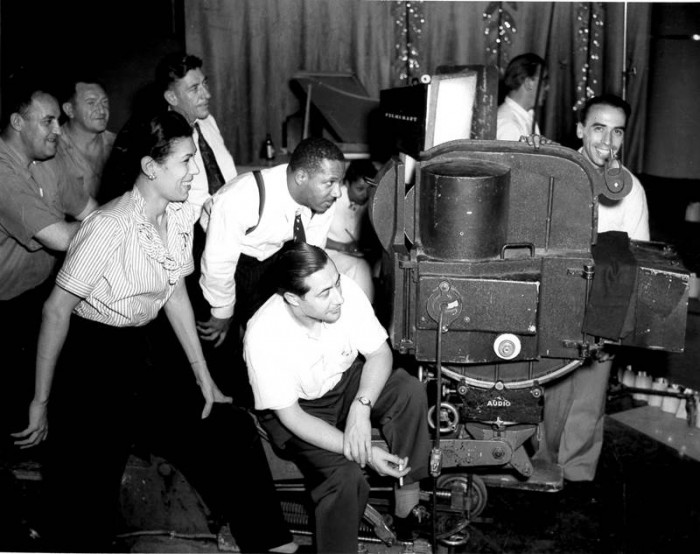 Filmmaker William Alexander (top-center) on set with crew, Filmcraft Studios, Bronx, NY, c.1946. (Collection of the California African American Museum)