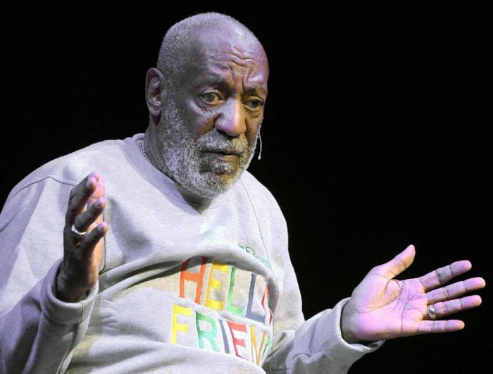 In this Friday, Nov. 21, 2014, file photo, comedian Bill Cosby performs at the Maxwell C. King Center for the Performing Arts, in Melbourne, Fla. On Monday, Dec. 14, 2015, Cosby filed counterclaims in federal court in Springfield, Mass., against seven women who are suing him for defamation, accusing them of making false accusations of sexual misconduct for financial gain. That same day, Boston University trustees voted to revoke an honorary degree awarded to Cosby during its May 2014 commencement. (AP Photo/Phelan M. Ebenhack, File)