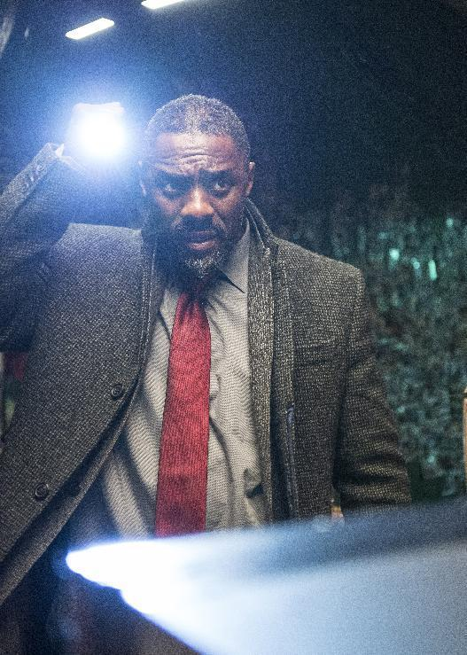 """In this image released by BBC America, Idris Elba portrays Detective Chief Inspector John Luther in a scene from """"Luther."""" Elba stars in a two-hour special airing at 9 p.m. EST Thursday on BBC America.  (Steffan Hill/BBC America via AP)"""