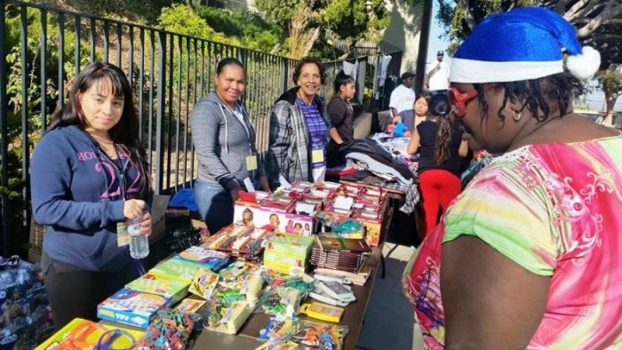 Before the clouds blew in and the rain poured, people lined up in droves, empty handed, but left with an abundance of holiday goodies on Saturday December 19, 2015 dubbed Humanitarian Day at Jesse Owens Park in Los Angeles (courtesy photo)