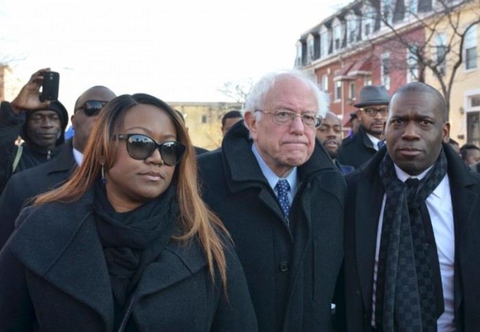 Pastor Lisa Weah and Pastor Jamal-Harrison Bryant show Sen. Bernie Sanders the impoverished conditions of Baltimore's Sandtown, where Freddie Gray grew up and where he was arrested, leading to his death. (photo: Freddie Allen/AMG/NNPA News Wire)