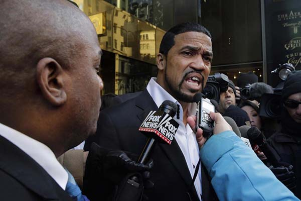 Pastor James Davis, right, from the Eternal Life Harvest Center in Knoxville Tenn., speaks to the members of the media outside Trump Tower in New York, Monday, Nov. 30, 2015. Trump is scheduled to meet  with a coalition of 100 African-American evangelical pastors and religious leaders in a private meeting at Trump Tower. (AP Photo/Richard Drew)