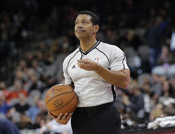 "NBA referee Bill Kennedy (55) during the second half of an NBA basketball game between the San Antonio Spurs and Utah Jazz, Monday, Dec. 14, 2015, in San Antonio. Kennedy has told Yahoo Sports he is gay after Sacramento Kings guard Rajon Rondo directed a gay slur at him during a game. Kennedy tells Yahoo he is ""proud to be an NBA referee and I am proud to be a gay man,"" adding that he chose to come out in hopes of sending a message ""that you must allow no one to make you feel ashamed of who you are."" (AP Photo/Eric Gay)"