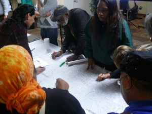Community members pick spots for trees on a map of the Crenshaw District. Photo by Brian W. Carter