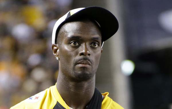 "FILE - In this Saturday, Aug. 10, 2013, file photo, Pittsburgh Steelers wide receiver Plaxico Burress (80) stands on the sidelines during an NFL preseason football game against the New York Giants in Pittsburgh. Former NFL star Plaxico Burress pleaded guilty Monday, Dec. 7, 2015, to New Jersey tax evasion charges after reaching a plea deal that could potentially spare him any jail time. Burress, 38, of Totowa, declined to comment on the plea he entered in state Superior Court, telling reporters to ""have a good day"" as he left the courtroom. (AP Photo/Gene J. Puskar, File)"