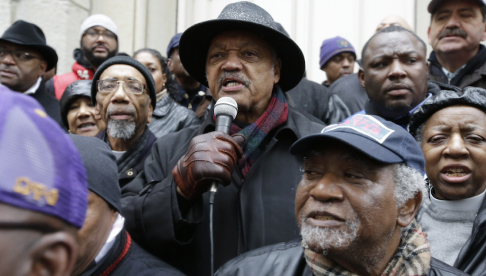 """2-The Rev. Jesse Jackson speaks to demonstrators on Friday, Nov. 27, 2015, in Chicago, as community activists and labor leaders hold a demonstration billed as a """"march for justice"""" in the wake of the release of video showing an officer fatally shooting Laquan McDonald. (AP Photo/Nam Y. Huh)"""