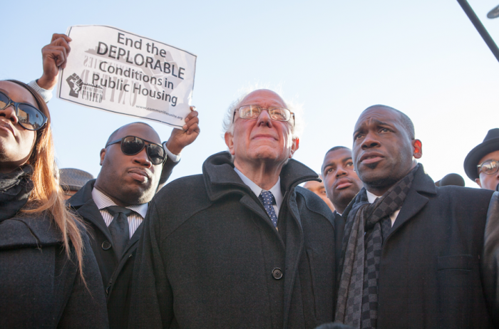 Sen. Bernie Sanders with Rev. Jamal Bryant (right) on a walking tour of the Sandtown-Winchester neighborhood in Baltimore. | Photo by Cheriss May, Howard University News Service.The CVS that was burned down during protests for Freddie Gray. Photo by Cheriss May, Howard University News Service.