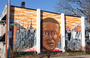 A Freddie Gray memorial mural seen on the side of a house across the street from where he was arrested. | Photo by Cheriss May, Howard University News Service.