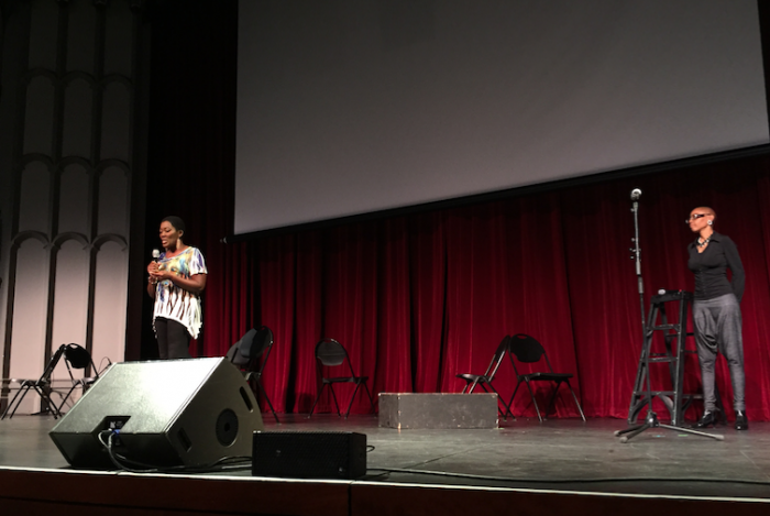 Akuyoe Graham and actress Debra Wilson kick off the poetry show with some background on the Spirit Awakening Foundation. (Amen Oyiboke/LA Sentinel)