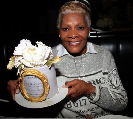 Legendary songstress Dionne Warwick holding her birthday cake topper. (Lisa Pacino/Duvet Productions.)
