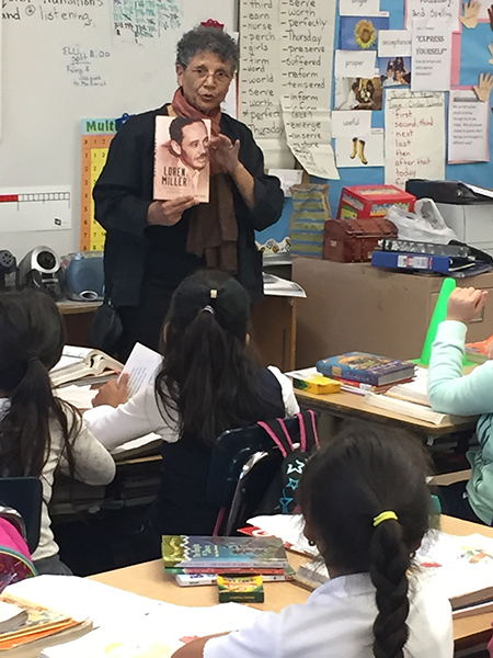 Amina Hassan, author of Loren Miller: Civil Rights Attorney and Journalist talks to 3rd graders at Loren Miller Elementary. (Courtesy of Julio Hanson)