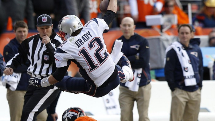 Broncos Aqib Talib tackles Patriots Tom Brady.  Photo:  David Zalubowski/AP