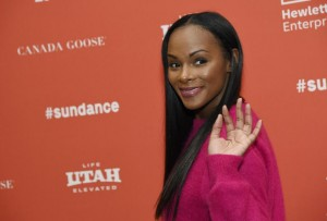 """Tika Sumpter, who plays a young Michelle Obama in """"Southside With You,"""" waves to photographers at the premiere of the film at the 2016 Sundance Film Festival on Sunday, Jan. 24, 2016, in Park City, Utah. (Photo by Chris Pizzello/Invision/AP)"""