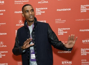 """Parker Sawyers, who plays a young Barack Obama in """"Southside With You,"""" poses at the premiere of the film at the 2016 Sundance Film Festival on Sunday, Jan. 24, 2016, in Park City, Utah. (Photo by Chris Pizzello/Invision/AP)"""