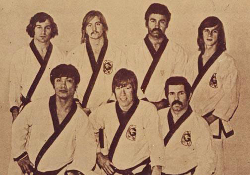 Back row top (left to right): V. Moogen, B. Burbege, D. Garcia and T. Updike, Front row (left to right): J. Natividad , Chuck Norris and P. Johnson. (Courtesy Photo)
