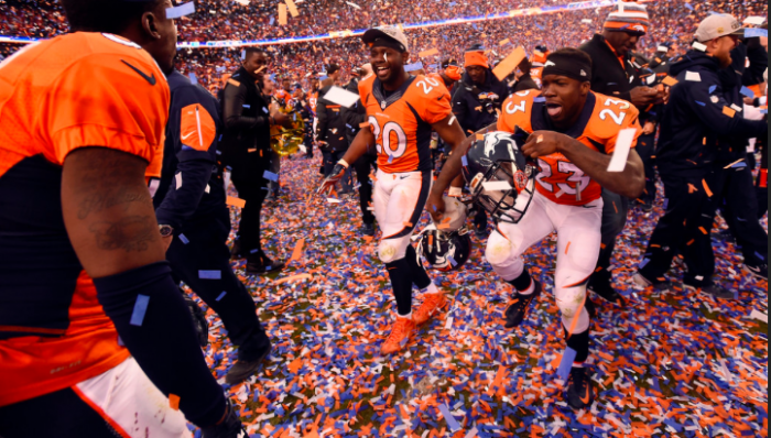 Broncos Safety Josh Bush (20) and Running Back Ronnie Hillan Savor the Moment.  Photo:  John Leyba