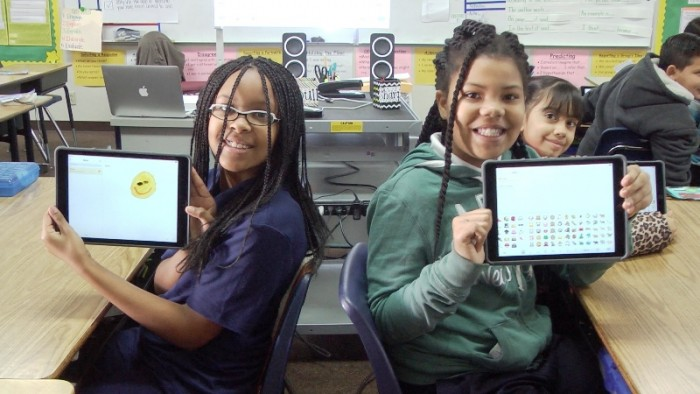 """Jefferson Elementary School fourth-graders Ryann Williams and Shamiya Comer show off their new iPads, Friday, January 15. """"You can do so many things with an iPad,"""" said Comer. Courtesy Photo"""