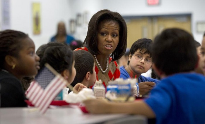 In this Jan. 25, 2012 file photo, First lady Michelle Obama has lunch with school children at Parklawn elementary school in Alexandria, Va. A bipartisan Senate bill released Monday would revise healthier meal standards put into place over the last few years to give schools more flexibility in what they serve the nation's schoolchildren, easing requirements on whole grains and delaying an upcoming deadline to cut sodium levels on the lunch line. (AP Photo/Pablo Martinez Monsivais)