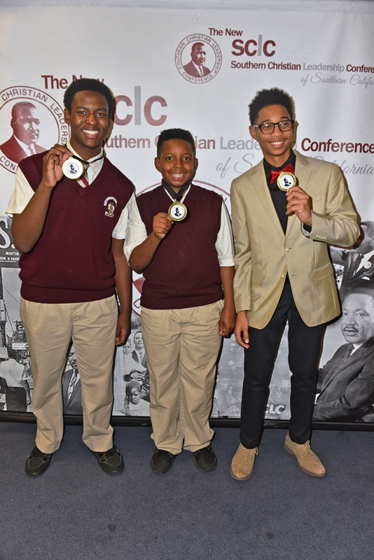 (L-R) Jordan Malbrew won in the art category, Randall King was middle school oratory winner and Kristian Emel received the top oratory prize in the high school group. (Ian Foxx Photo)