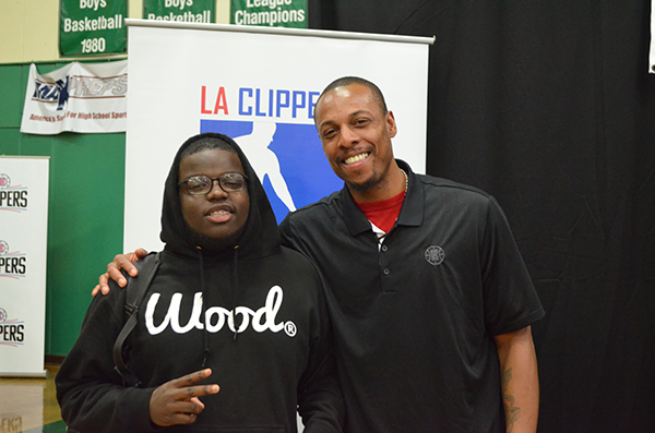 Paul Pierce poses with high school student after giving him a pair of eye glasses (Amanda Scurlock/ LA Sentinel)