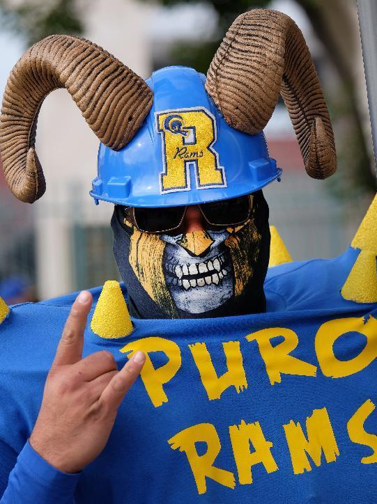 Rams fan Enrique Lopez, arrives for a rally at the historic Los Angeles Memorial Coliseum. Saturday, Jan. 9, 2016 in Los Angeles. Boisterous Los Angeles Rams fans gathered Saturday to herald the NFL football team's possibly imminent return to Southern California after a 21-year sojourn in St. Louis. (AP Photo/Richard Vogel)
