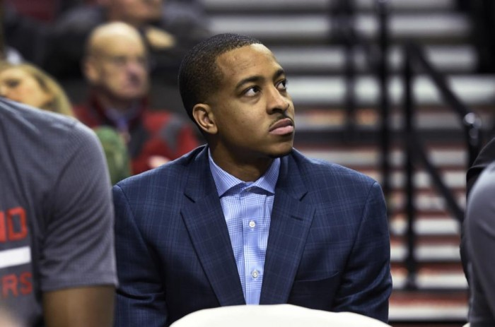 Portland Trail Blazers guard C.J. McCollum sits on the bench during the second half of an NBA basketball game against the Los Angeles Clippers in Portland, Ore., Wednesday, Jan. 6, 2016. McCollum was inadvertently left off the roster and did not play in the game. The Clippers won 109-98. (AP Photo/Steve Dykes)