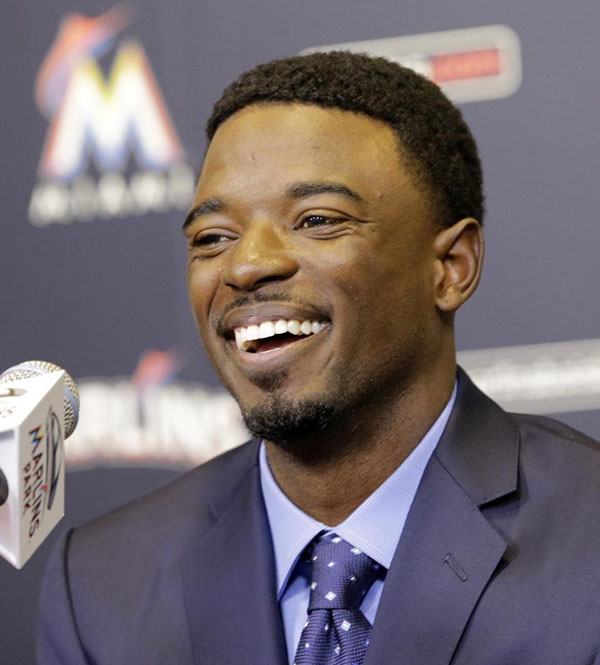 Miami Marlins second baseman Dee Gordon smiles as he answers a question during a news conference, Monday, Jan. 18, 2016, in Miami. NL batting champion Dee Gordon has signed a five-year contract with the Miami Marlins. An agreement was reached last week on the deal for $50 million, which also includes a $14 million club option for 2021. The Marlins announced the signing Monday, Jan. 18, 2016. (AP Photo/Alan Diaz)