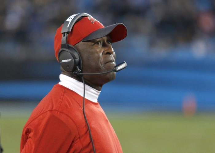 FILE - In this Jan. 3, 2016, file photo, Tampa Bay Buccaneers coach Lovie Smith watches his team take on the Carolina Panthers during an NFL football game in Charlotte, N.C. The Buccaneers fired Smith on Wednesday night, Jan. 6. Smith went 6-10 this year and 8-24 over two seasons in charge of the team. The announcement came as a surprise to many because Smith's job was not considered to be in danger.(AP Photo/Bob Leverone, File)