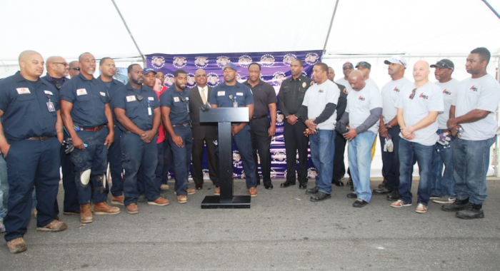 "LRS Plumbers team members joined by Los Angeles County Fire Chief Daryl Osby, STENTORIAN President and Battalion Chief Robert Harris, Fire Captain Joe Williams and Inglewood Mayor James T. Butts at press conference for annual ""Our Season of Giving."" (Courtesy Photo)"