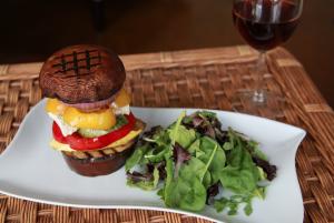 Chef Jess' vegan mushroom burger with side salad.