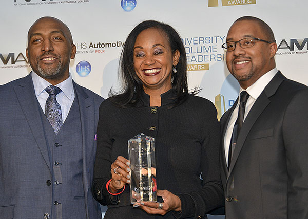 Alva Adams-Mason, the director of African American Business Strategy and Corporate Communications of Toyota North America (center) accepts a Diversity Volume Leadership Award for the Toyota team from Marc Bland, the vice president of diversity and inclusion for IHS Automotive (left) and Damon Lester, the president of NAMAD at the Diversity Volume Leadership Awards in Detroit, Mich. (Freddie Allen/AMG/NNPA News Wire Service)