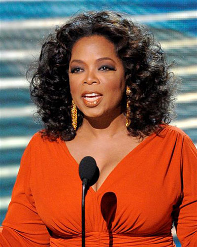 Oprah Winfrey opens the 60th Primetime Emmy Awards Sunday, Sept. 21, 2008, in Los Angeles. (AP Photo/Mark J. Terrill)