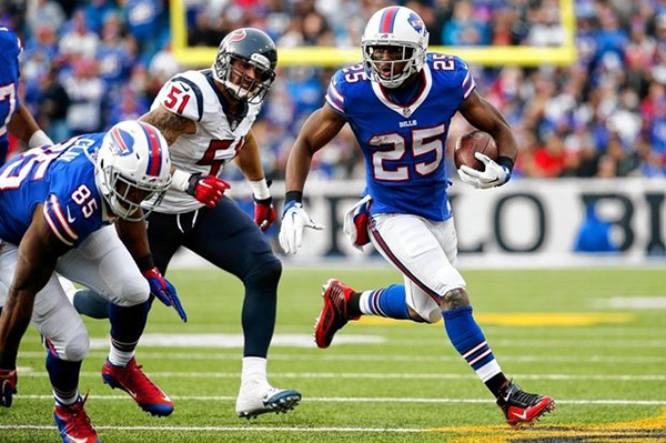 Buffalo Bills running back LeSean McCoy (25) runs with the ball against the Houston Texans during the first half Sunday in Orchard Park, N.Y. (Bill Wippert | The Associated Press)