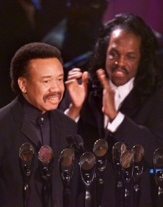 Bass guitar player of Earth, Wind & Fire, Verdine White, right, applauds his older brother and the band's leader, Maurice, as the group is inducted into the Rock and Roll Hall of Fame during the 15th Anuual induction dinner in New York Monday evening, March 6, 2000. The band, which rose to prominence in the Seventies, solidified the growth of black album music as it brought together the earlier sounds of jazz, blues, R&B, pop, gospel, funk and deep soul.  (AP Photo/Kathy Willens)
