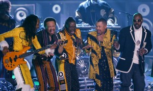 The group Earth, Wind & Fire perform during a tribute to funk during the 46th Annual Grammy Awards, Sunday, Feb. 8, 2004, in Los Angeles. (AP Photo/Kevork Djansezian)